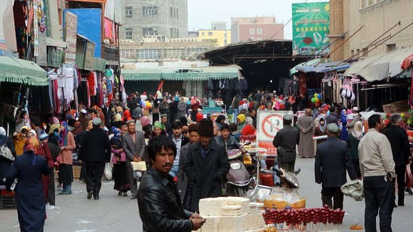 Chinese authorities offer money for mixed marriages in bid to quell Uighurs