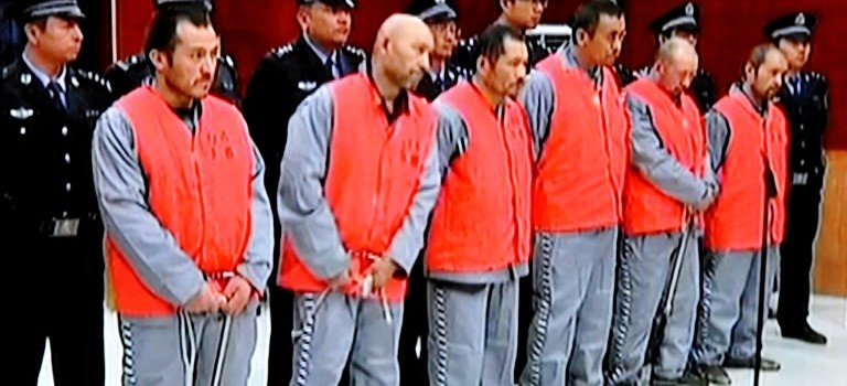 China court sentences 12 to death for Xinjiang attacks